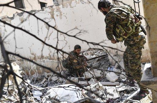 Des combattants des FDS à Raqa, en Syrie