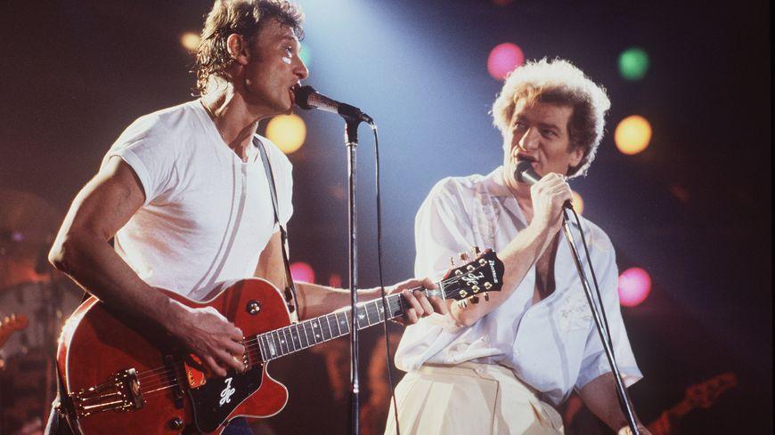 Johnny Hallyday et Eddy Mitchell sur la scène du Printemps de Bourges le 1er avril 1985.