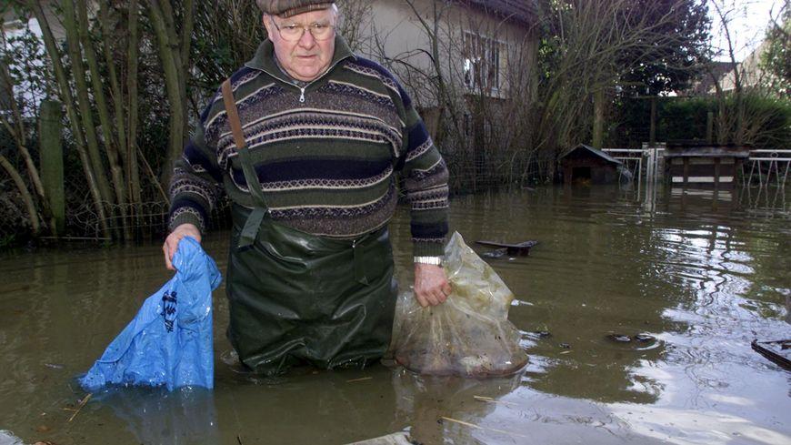 En 2001, les habitants de Louvigny avaient les pieds dans l'eau.