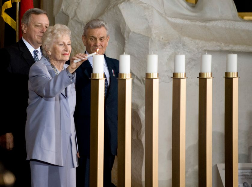 UNITED STATES From left, Sen. Richard Durbin, D-Ill., watches as Irene Boyarsky and Tadeusz Stankiewicz light a candle during the Days of Remembrance Ceremony in the Capitol Rotunda on Thursday, April 23, 2009, to commemorate the Holocauste