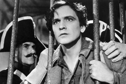 Jean Valjean en prison dans le film Les Misérables avec Frédéric March