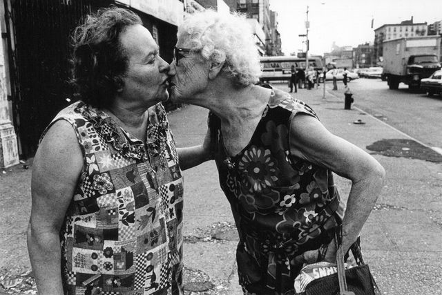 Arlene Gottfried - Sometimes overwhelming - Mommie kissing Bubbie on Delancey Street New York, 1979