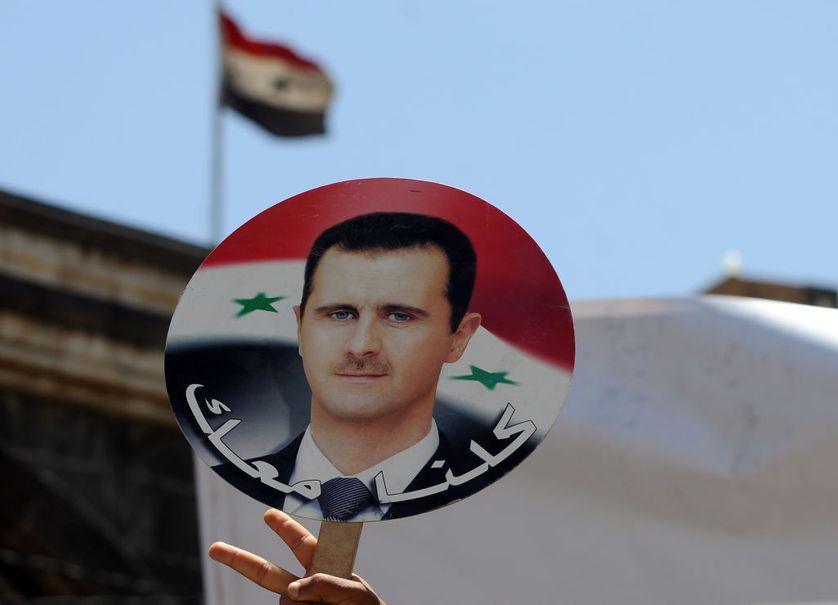 Portrait du Président syrien Bachar al-Assad au Yémen en avril 2018