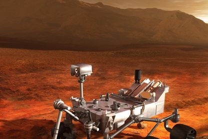 Le Rover Curiosity de la NASA échantillonne un rocher sur le sol de Gale Crater, le cratère de la planète Mars