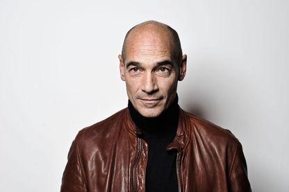 Jean-Marc Barr, acteur, réalisateur et photographe franco-américain, connu pour son rôle dans Le Grand Bleu de Luc Besson.