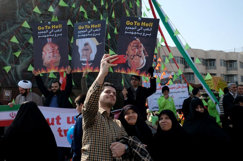 Demonstration against Foreign leaders. Banners of D. Trump and B. Netanyahu and king Salman of Saudi Arabia held upside down by demonstrators in the Revolution Square on the 39th anniversary of Islamic Revolution on February 11, 2018 in Tehran, Iran