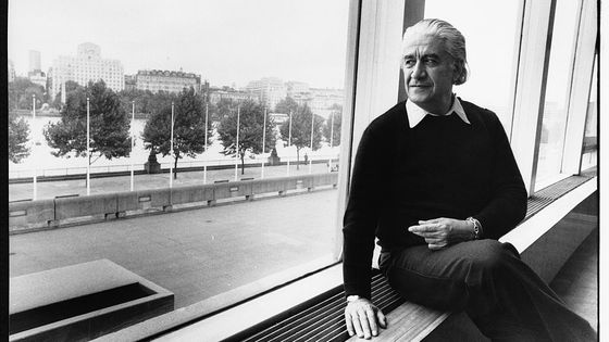 Musician Sergiu Celibidache sits on a windowsill at the South Bank Centre