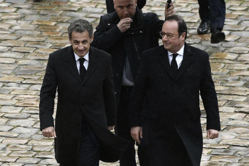 Nicolas Sarkozy et François Hollande, le 28 mars 2018.