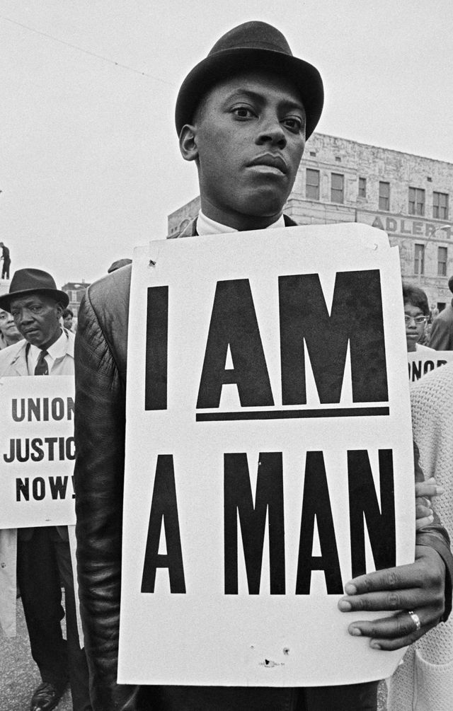 Mourner with sign at the King memorial service, 1968