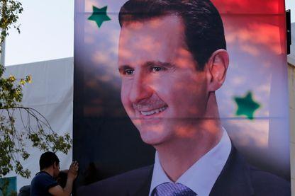 Panneau à la gloire du Président Bachar el-Assad à Damas, en juin 2018.