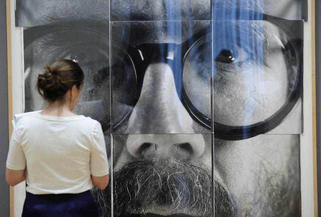Un portrait Polaroïd grand format de Chuck Close, ici en 2010