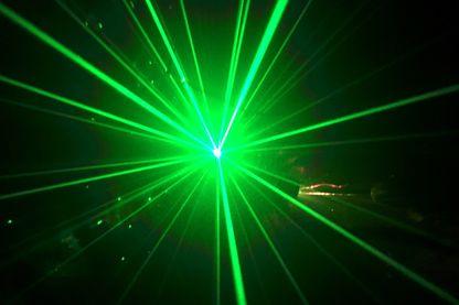 Green colored laser light in a dark room