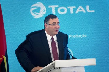 CEO of France's Groupe Total Patrick Pouyanne(L) speaks at the inauguration of the Total Kaombo oil project in Luanda on November 10, 2018