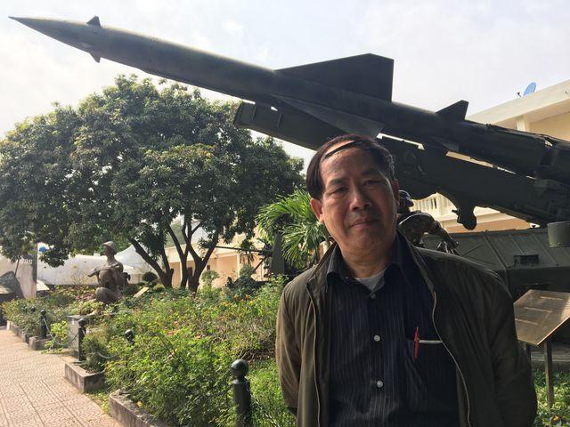 Pham Cong Dung, ancien soldat, dirige maintenant une société d'import-export de bois