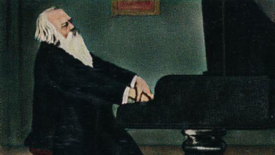 Le compositeur Johannes Brahms au piano