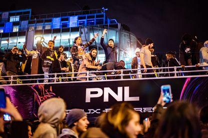PN. Ademo (Tarik Andrieu) et N.O.S (Nabil Andrieu) et sa team QLF défilent en bus à impériale sur les Champs Elysées le 5 avril 2019 à Paris