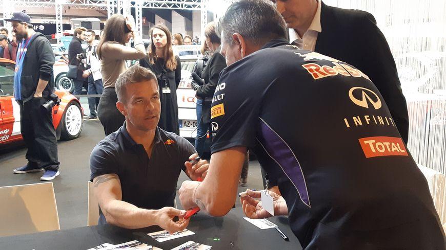 Sébastien Loeb sur le stand de son écurie, le Sébastien Loeb Racing.