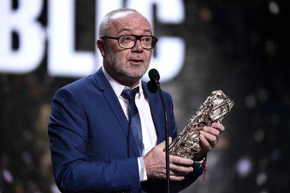 """Olivier Baroux, comédien, réalisateur et humoriste reçoit le prix du public pour """"Les Tuches"""" lors de la 44e édition de la cérémonie des César du film le 22 février 2019."""