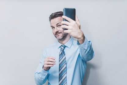 Business man doing selfie