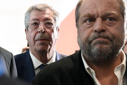 Patrick Balkany (à gauche) arrive au tribunal de Paris avec son avocat Eric Dupond-Moretti, le 13 mai 2019.