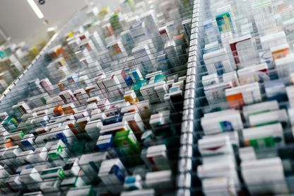 Medicine in shelves in commissioning machine in pharmacy