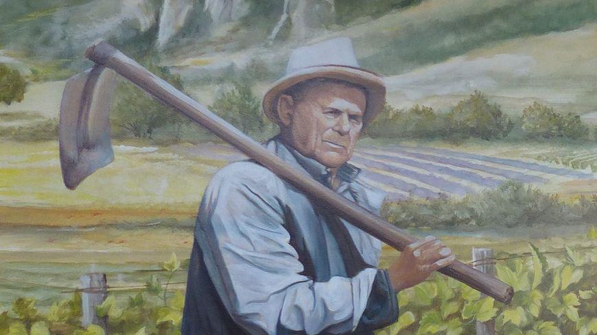 Fresque du musée de la Clairette, viticulteur au travail dans les vignes.