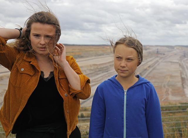 La militante allemande Luisa Neubauer accompagnée de Greta Thunberg lors d'une action en Allemagne, en août 2019.