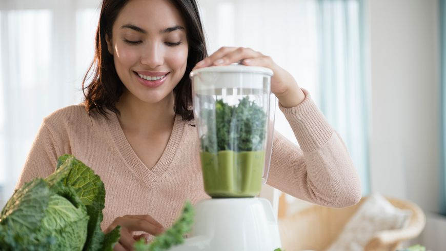 Hispanic woman blending healthy smoothie - Photos