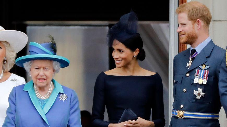 La reine Elizabeth, Meghan et Harry au balcon de Buckingham Palace en juillet 2018.
