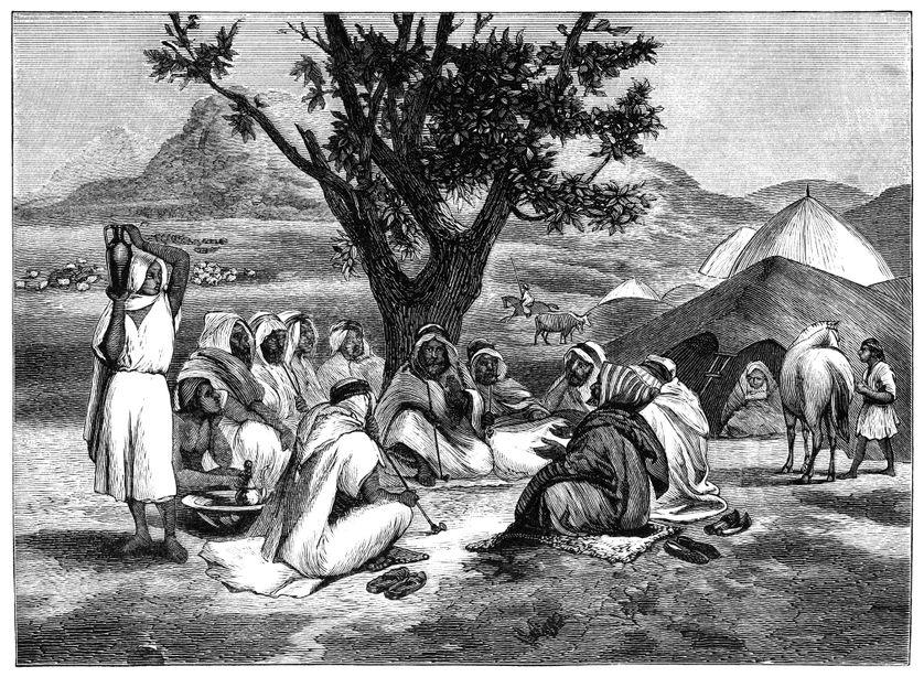 "Histoire racontée dans le désert, ""An Arab storyteller with a spell-bound audience, sitting beside their tents in a desert oasis."" gravure publiée par Thomas Y. Crowell & Co., New York, 1882."